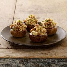 Johnsonville® Sausage Stuffed Mushrooms Recipe -This Johnsonville recipe is a must for mushroom fans!  The taste of Johnsonville Italian Sausage pairs well with cream cheese, Parmesan cheese, lemon and garlic to create a dish that's bound to please!  These stuffed mushrooms are perfect for an appetizer when you're entertaining family and friends.