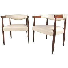 Pair of Mid-Century Modern Walnut Frame Barrel Armchairs | From a unique collection of antique and modern armchairs at https://www.1stdibs.com/furniture/seating/armchairs/