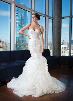 Justin Alexander signature wedding dresses style 9740 Sequins, pearls, and bugle beads cover the sweetheart neckline and full bodice on this mermaid gown. Tiered laser cut organza creates a soft skirt and a sweep train. Fabric buttons cover the back zip  | followpics.co