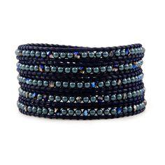 tahitian Swarovski pearls and metallic blue Swarovski crystals on dark blue colored leather