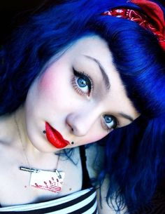 bold, bright blue long hair with suicide bangs - This shade looks amazing with her blue eyes!