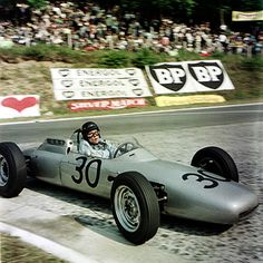 Dan Gurney gives Porsche its first Grand Prix win at the 1962 French Grand Prix.