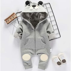 * Adorable bear pattern<br /> * Hooded design<br /> * Ribbed cuffs<br /> * Zipper front<br /> * Material: 70% Cotton, 30% Others<br /> * Include: 1 romper, 1 headband<br /> * Machine wash, tumble dry<br /> * Imported<br /> <br /> Super cute bear romper for your sweet baby, zipper front design, and ribbed cuffs keep you little one   <br /> warm in the cool weather.