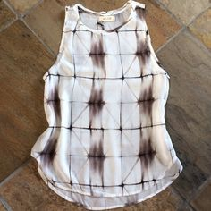 """🍃💗Anthropologie Abstract Semi-Sheer Tank Light as air, cool comfort 100% Tencel easy wash and wear fabric tank top. Quality made proudly in the USA. Effortless style in this neutral pair with everything top. High low pull on styling. Standard Anthro fit. Bust laying flat, S 18"""", M 19"""", L 21"""". Front approximately 25"""" in length, back 27"""" (length measurements taken from a Small). Ultra soft, semi sheer. A perfect layering piece. No trades ever. Anthropologie Tops Tank Tops"""