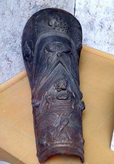 Decorated bronze shin guard (greave) with head of Silenus, Capua Gladiator Museum, Capua | Flickr: Intercambio de fotos