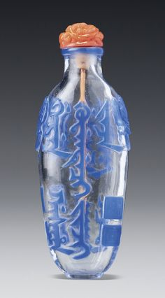 sothebys.com ~ AN IMPERIAL INSCRIBED 'MANCHU SCRIPT' SAPPHIRE-BLUE OVERLAY GLASS SNUFF BOTTLE IMPERIAL WORKSHOPS, QING DYNASTY, QIANLONG / JIAQING PERIOD