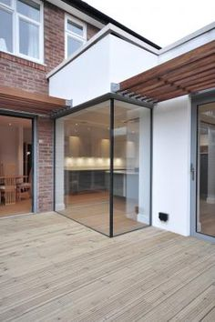 This modern extension utilises frameless glass to bring the outside into this family home. Glass Extension, Extensions, Home And Family, Outdoor Decor, Modern, Design, Home Decor, Trendy Tree, Decoration Home