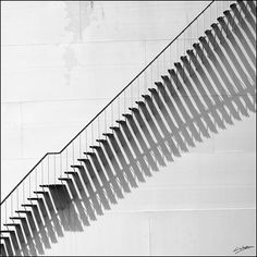 i love this partial abstract image. The way the light is creating long shadows, giving a good pattern and movement, and also the strong leading lines, making your eye go up  the staircase.