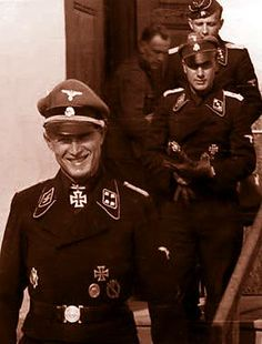 Waffen SS Tank Commander Panzer officer Michael Wittmann - TIGER ACE- nickname Black Baron of World War II - He service Waffen SS Rank: Hauptsturmfuhrer Jung and very brave He got the Knight's Cross of the Iron Cross from Adolf Hitler