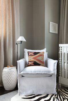 Upholstered Glider Chair with Kilim Pillow - amazing look in this neutral safari-inspired nursery!