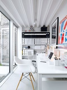 home office - like the simple long table and white and black with a little wood