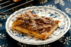 Pissaladière. Pissaladière is a pizza with onion, olives, and anchovies. Beautifully simple and totally delicious.