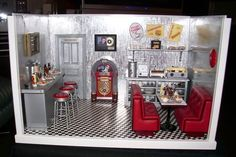 The Doo Wop Diner was created with items purchased at Out of the Ordinary Miniatures.  The battery operated LED lights and working juke box make it extra special.