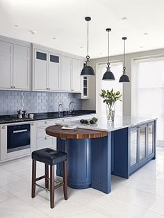 White and blue kitchen features white cabinets painted Benjamin ...