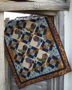 Put on an old country favorite and grab your favorite cowboy or cowgirl for some snuggle time western style. The quilt pictured on the cover features western prints and batiks, but whose to say your b