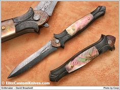 """This folding dagger was created for Elite Custom Knives. The blade is Tom Ferry mosaic damascus steel, the bolsters are random damascus, and the scales are black lip mother of pearl. The liners are titanium with a side lock. The knife is assembled with hidden screws, and the """"nuts"""" that hold the scales in place are made from 14k gold."""