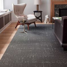 Like the grooves in a vinyl record, this rug shows its very subtle hatchings with style. Reminiscent of classic Mid-century design, it has confidence and swank without being showy. Pair it with modern pieces or vintage decor. This is a random pattern and no two tiles are alike. The pattern will not align.