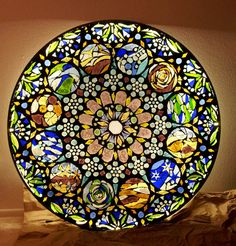 This was a plain glass table top! WOW what a makeover!  Make Stained Glass Mosaic Wall Light
