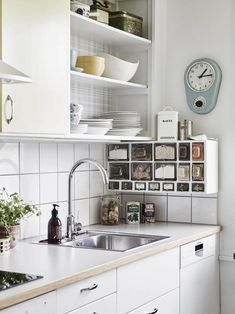 Spice rack // Love this! Brilliant way to mix an original built-in kitchen (upper cabinets) with modern kitchen interior (bottom cabinets). Also: pastel colors! New Kitchen, Kitchen Dining, Kitchen Decor, Kitchen Ideas, Rustic Kitchen, Dining Room, Kitchen Countertop Organization, Kitchen Cabinets, Upper Cabinets