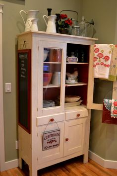 Red and white cabinet and the cute chalkboard idea