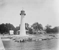 Biloxi Lighthouse...We drive by this all the time. It looks different now, but the light house is still tall and very pretty! The building behind it is still there, it's now a visitors center/historic museum. <3