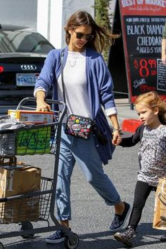 Jessica Alba wearing Cartier Juste Un Clou Bracelet, Dior Denim Blue Slip-on Sneakers, Anya Hindmarch All Over Stickers Crossbody and Inhabit Perforated Crew Sweater in Blanc