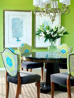Vivid setting Bold wall color and fabric choices energize this dining room. Dark wood and light art balance the effect.