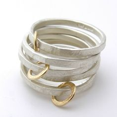 Beautiful hand made Silver and gold hoop rings by the fabulous British designer Jane Kenny.The image shows the silver with gold hoops rings mixed up with some of Janes plain silver rings. The price for each silver and gold hoop ring is Real Gold Jewelry, Sea Glass Jewelry, Gold Jewellery, Jewellery Shops, Women's Jewelry, Fine Jewelry, Luxury Jewelry, Jewellery Stand, Designer Jewellery