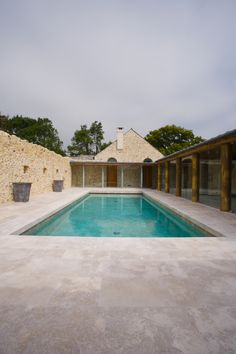699aefabe4f5 Beautiful outdoor swimming pool with limestone terrance from Artisans of  Devizes.