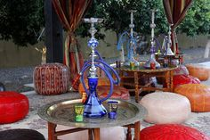 Moroccan and Arabian nights themed party entertainment and decoration ideas. Hookah lounge, via Flickr.