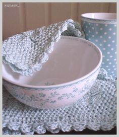 Crochet lace placemats and pretty pastel blue porcelain bowl and mug.