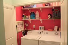 A Bright Pink and well organized laundry room! you can do a lot with a small laundry closet