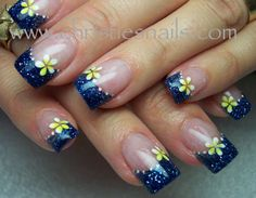 Dark blue glitter tips, with yellow flowers accents ~ by Christie's Nails. The blossoms look like Hawaiian plumerias!