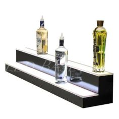 """Bottle Glorifier 2 Step 80 Display Liquor by Led Baseline Inc. $685.00. These lighted bottle shelves feature a thin first level shelf and a taller second shelf that gives great bottle label exposure and allows for easy placement and removal. Construction These units are built to suit your needs, simply select the width option that fits your bar Dimensions: 7"""" tall x 8.5"""" deep x 80"""" Semi-gloss black finish and impact, scratch resistant acrylic top LED specs ..."""