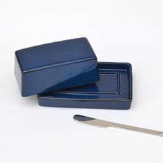 Covered ceramic butter dish with stainless steel butter knife. Simple, but beautiful design keeps butter fresh. Made in Japan. Available in 5 colors.
