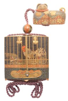 A broad gold-lacquer and Somada inlaid three-case inro in the form of an elaborate, tasselled bird cage The inro and en-suite lacquer hako-netsuke probably by Shunsho IX (Masaaki), Shunsho X (Masakane) or Shunsho XI (Masaoki), Meiji era late 1 Rooster Art, Meiji Era, Turning Japanese, Tea Caddy, Art Uk, Japan Art, Everyday Items, Japanese Design, Asia