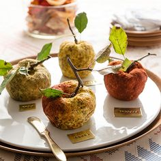 """""""Party Food: Smoky Cheese Balls""""   Sometimes it's OK to play with your food. These adorable apple-shape cheese balls one-up any other cheese tray and are so simple to make. Just roll your choice of cheese into a ball -- the lumpier the better."""
