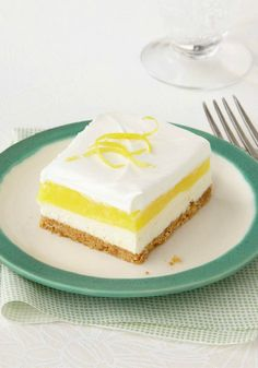 Creamy Layered Squares – Graham cracker crust and luscious layers of creamy whipped filling, lemon pudding, and airy whipped topping in a dessert recipe that takes just 15 minutes? Yes.