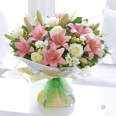 Spring Rose Lily and Freesia Handtied - The sweet scent of #freesia is one of the pleasures of the season – and one of the things they'll love about this elegant hand-tied bouquet. And the distinctive dusky pink hue of the roses and lilies gives this design a timeless quality that is sure to be loved by all. #Spring #Flowers