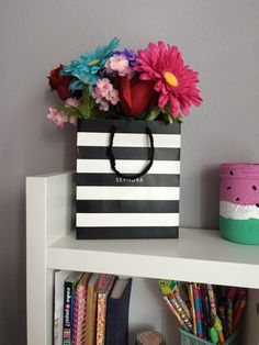 I took a Sephora bag and put some fake flowers in it. It looks super cute!