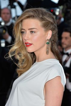 Amber Heard attended the Cannes debut of Two Days, One Night, wearing a braided undercut hairstyle and a classic red lipstick.