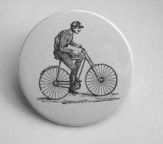 Vintage bike + mustached man. Fantastic.