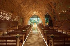 This enchanting wedding chapel in Hiroshima, Japan features 100 hand-carved wood panels. It was done in collaboration with a kimono designer.