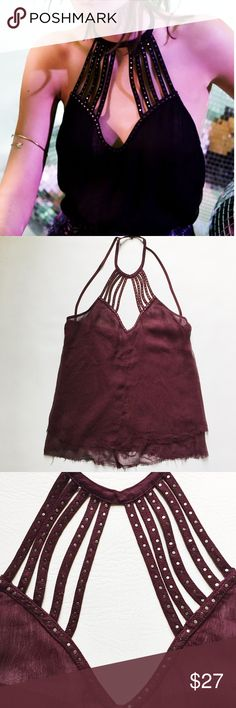 """Urban Outfitters Mystic Disco Harness Top Urban Outfitters Pins and Needles Mystic Disco Harness Top in burgundy featuring raw hem and caged neckline and open back.  Pre-loved but in excellent condition.  No holes, stains or tears.  Blogger babe shows fit, wearing different color.   Measurements laying flat: Armpit to armpit: 17"""" Waist (across): 17"""" Total length: 27.5"""" (approx.) Urban Outfitters Tops"""