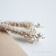A subtle version - handmade felt, sterling silver, freshwater pearls. Suitable even for brides in natural