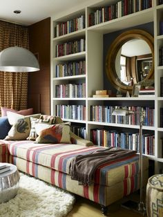 Reading Corner Design. The round mirror in the square shelves and striped chaise are cute!