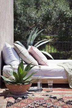 amafli coast rental with outdoor bed on patio. / sfgirlbybay