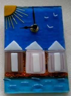 Beach huts wall clock £50.00