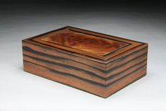 Kalos (kal-ahs) means beautiful, physically or morally. It is distinctly the beauty which comes from harmony, the beauty which arises from a symmetrical adjustment in right proportion. This edition of Kalos is veneered with macassar ebony. The sides of this box were veneered in one long piece. This Amboyna Burl, Redwood Burl, Walnut Burl, Wraps, In The Tree, Wood Boxes, Box Design, Jewelry Box, Decorative Boxes