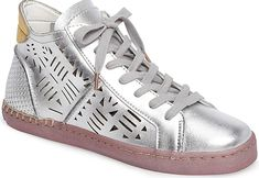 Dolce Vita Women's Shoes in Silver Lea Color. Laser-cut detailing and mixed finishes create intriguing textural interplay on a mid-top sneaker that makes a trend-right statement. Silver Shoes, Pumps, Heels, Silver Color, Women's Shoes, Footwear, Booty, Stylish, Create